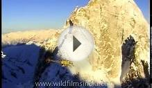 Helicopter flight over highest mountain range in the world